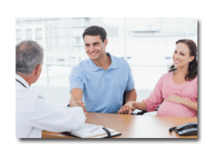Young couple meeting with a obstetrician