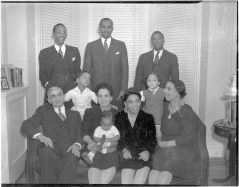 Jackson and Mitchell Families. Keiffer Jackson (seated left), Juanita Jackson Mitchell (seated second from left), Virginia Jackson Kiah (seated second from right), Dr. Lillie May Carroll Jackson (seated far right), Clarence Mitchell, Jr. (standing, center), undated. Paul Henderson, HEN.00.B1-052.