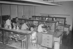 Classroom. Unidentified men and women in lab classroom, ca. 1947. Paul Henderson, HEN.00.B2-251.