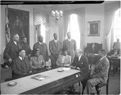 Board members of the Cheltenham School for Boys, appointed by Governor Preston Lane, Jr. Willard Allen, far left; Violet Hill Whyte, seated second from left; Bertha Proctor, seated in center; Edward Wilson, standing far left; John T. Colbert, standing far right; Governor Preston Lane, Jr., seated second from right. Governor's house, Annapolis, Maryland. circa 1951. Paul Henderson, HEN.00.A2-206.