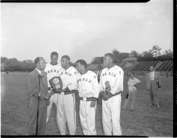Sam Lacy with MSU relay team, 1949. Paul Henderson, MdHS, HEN.01.14-041.