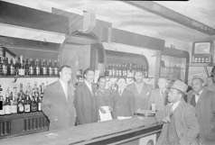 Interior of unidentified bar. Shows staff and customers, circa 1949. Paul Henderson, HEN.00.A1-015.