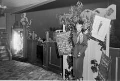 Interior view of theater. Lobby area with Hendin's Hollywood Fashion store advertisement display. Regent Theatre, 1619 Pennsylvania Avenue, circa 1950. Paul Henderson, HEN.00.B1-038.