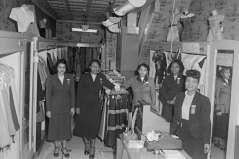 Women inside clothing store, circa 1953. Paul Henderson, HEN.00.B1-106.