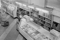 Interior view of grocery store, taken from upper floor, circa 1948. Paul Henderson, HEN.00.B1-121.