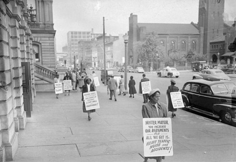Men and women outside Baltimore City Hall protesting intention to convert McCulloh Street into a one-way street. Paul Henderson, ca. 1950. MdHS, HEN.00.A2-144.