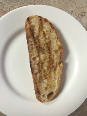 Tartine step 1: butter, grilled artisan bread