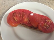 Tartine step 2: layer with fresh, sliced tomatoes