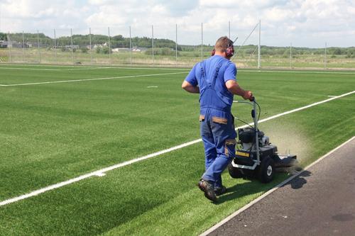 artificial grass brush maintenance cleaning
