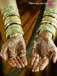 The richness of henna complements a rust sari