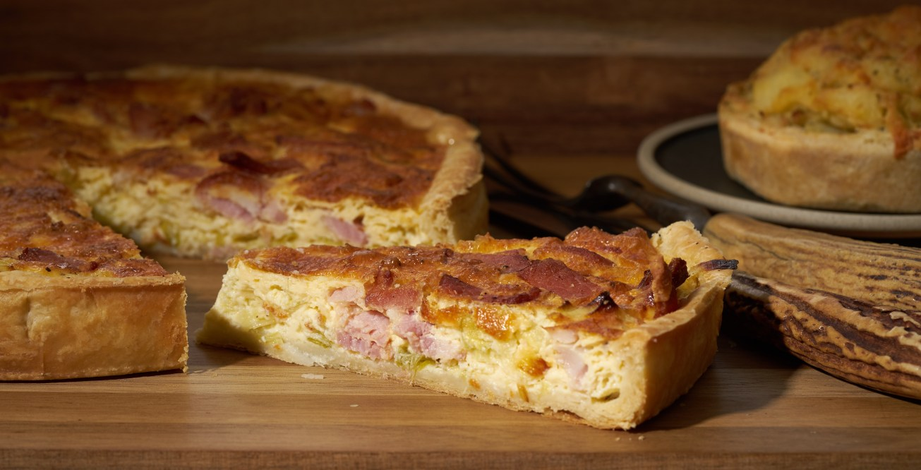 Food photography of cheese, onion and ham quiche
