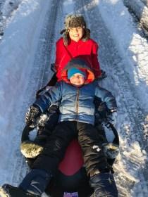 Mrs. Knighton's kids, John and Graham sledding.