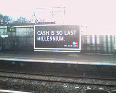 cash-is-so-last-millennium-billboard.jpg