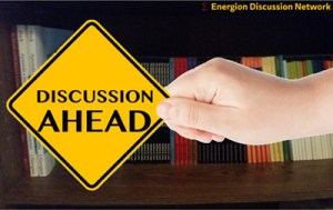 Discussion Ahead traffic sign in woman's hand on a white background