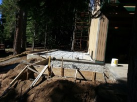 Garage. deck post supports and walkway in front of garage ready for cement