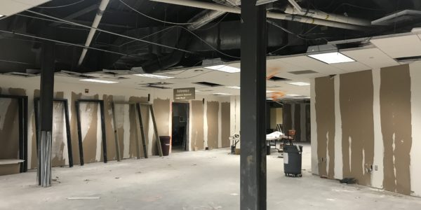 The former teen zone ceiling is getting mechanical work done as the wall are stripped.