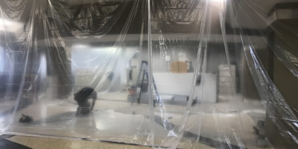 A clear tarp separates the circulation desk.