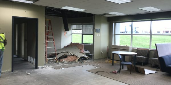 A wall that separated the TeenZone from the Youth Service Department's offices is removed.
