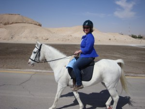 Omi & Cheeky, riding past a jebel