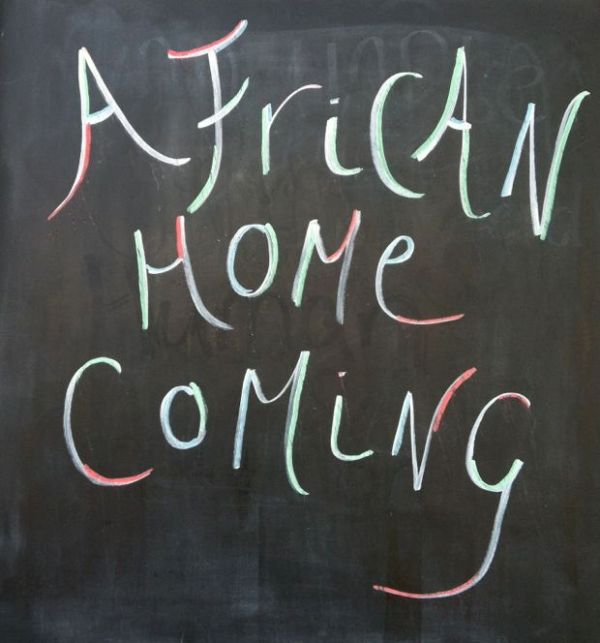 African Homecoming sign