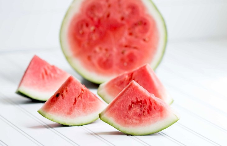 Beautiful Watermelon Slices Sitting on a Wooden Table