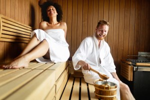 couple resting and sweating in sauna