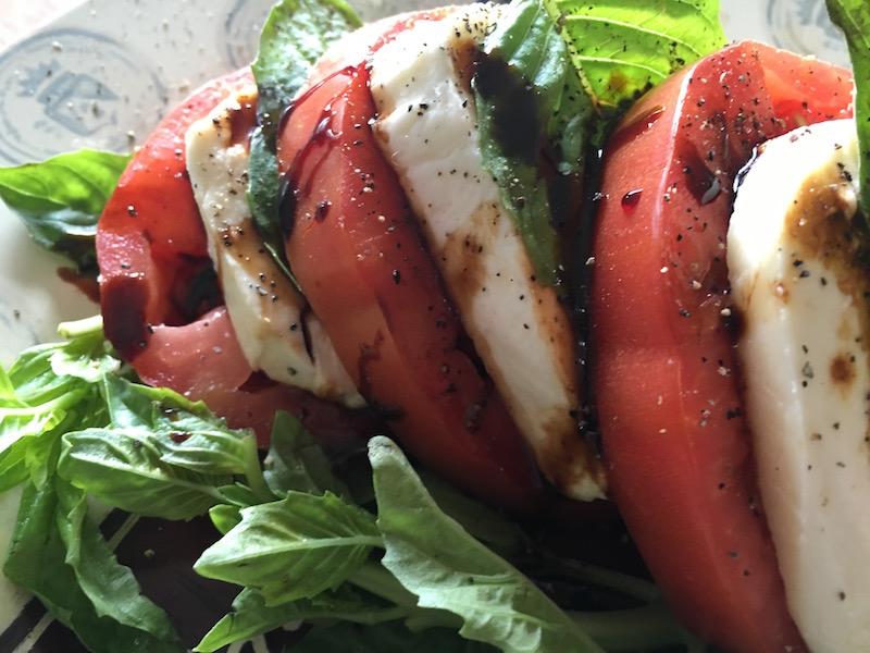This classic Caprese Salad recipe combines the unbeatable combination of fresh basil, mozzarella and tomatoes and tops them off with a delicious balsamic glaze. #capresesalad #saladrecipes #basil