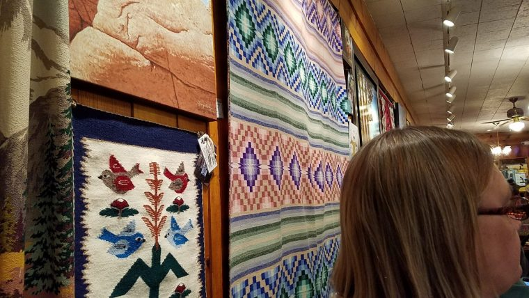 Navajo woven rugs for sale on the wall in the dining room