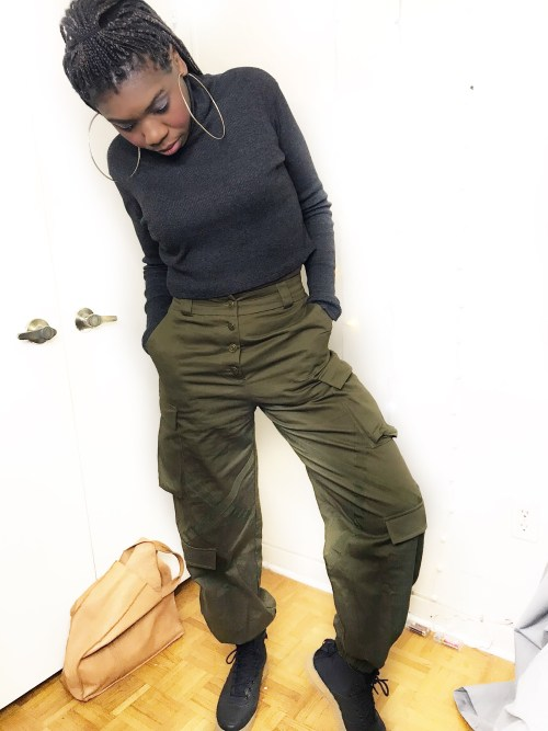 Telly poses in her olive green combat pants