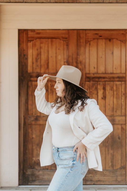 girl in hat wearing white sleeves