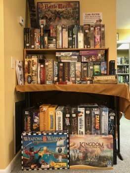 Some of the games up for sale in the April 2019 Game Auction at Here Be Books & Games