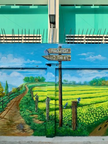 Wall mural pointing to Ho Thi Ky flower market
