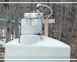 Sap tank with vacuum apparatus on top