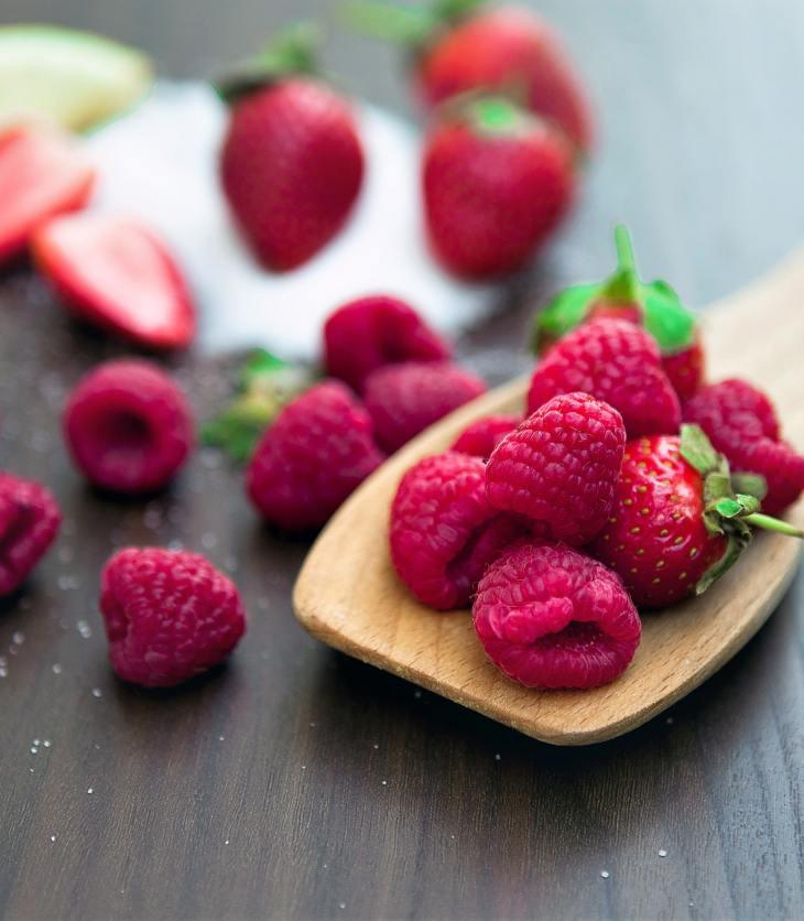 red raspberries on a spoon
