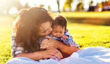 woman cuddling son