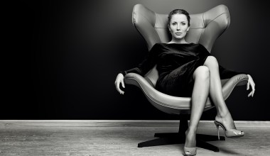 women sitting in office chair like a boss