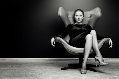 women sitting in office chair like a boss