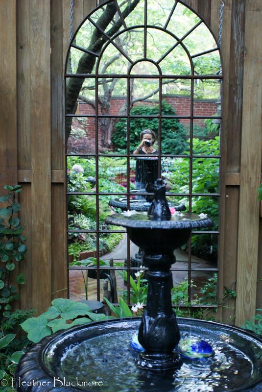Wall mounted garden mirror