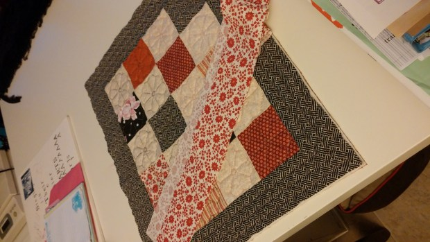 binding black and red quilt