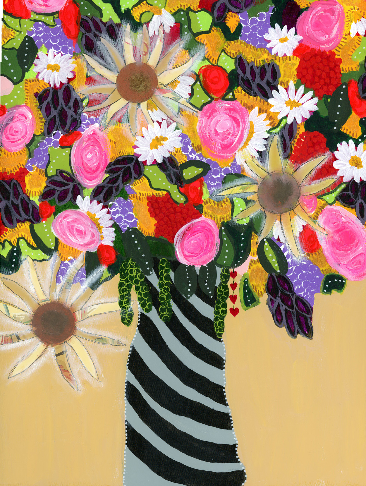 A bouquet full of colorful garden flowers in a grey and black striped vase.