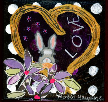 A little grey bunny with a carrot surrounded by a gold heart and lavendar flowers.
