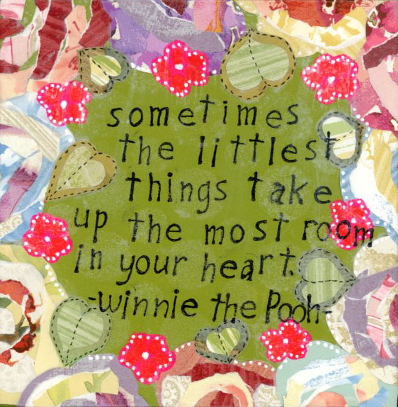 A mixed media painting with paper flowers adorning the edge.  A Winnie the Pooh quote is included in the center.