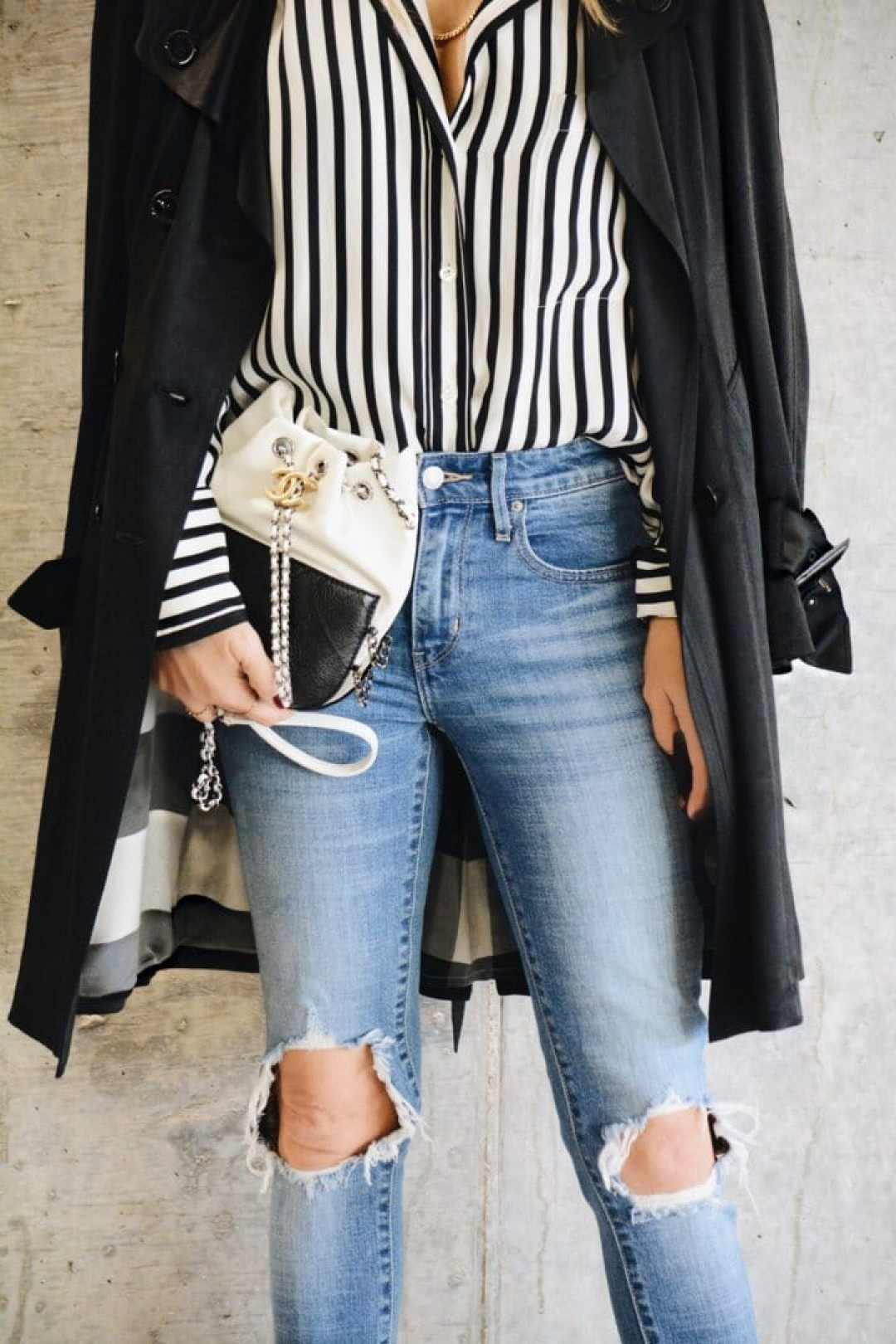 Black and White Blouse with Stripes, Chanel Black and White Bag, Distressed Denim and Black Coat Style by Her Fashioned Life