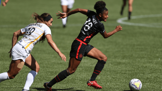 Simone Charley races away with the ball in the Portland Thorns' 3–0 victory over the Utah Royals.
