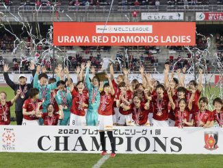 Urawa Red Diamonds celebrate after winning the Nadeshiko League women's football title with a trophy lift.