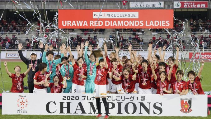 Urawa Red Diamonds celebrate after winning the Nadeshiko League women's football title with a trophy lift.