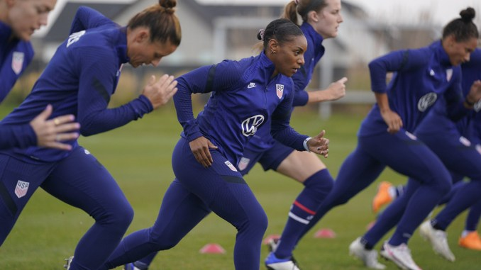 Crystal Dunn runs drills with her USWNT teammates.