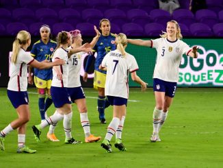 Sam Mewis celebrates with her USWNT teammates after scoring her second goal.