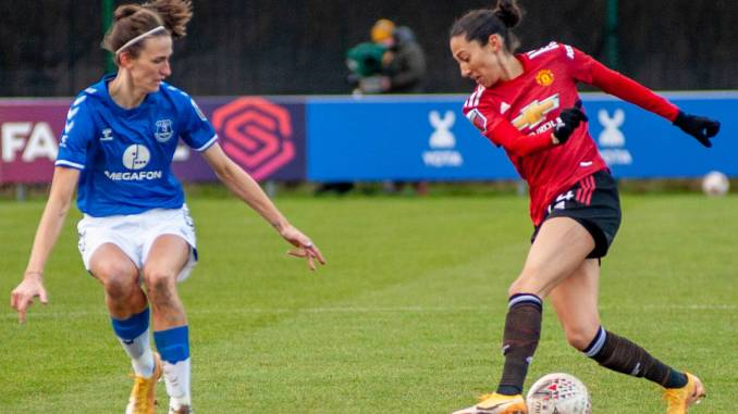 Manchester United's Christen Press controls the ball as Everton's Jill Scott looks to steal possession.