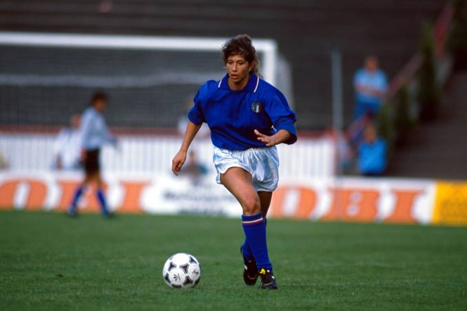 Italy's Carolina Morace dribbles the ball.